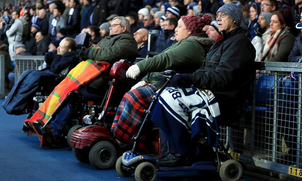 Fans with reduced mobility watch a Premier League game from a designated wheelchair area at The Hawthorns, the home of West Bromwich Albion