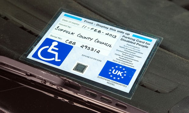 Image of blue badge parking permit on a car window
