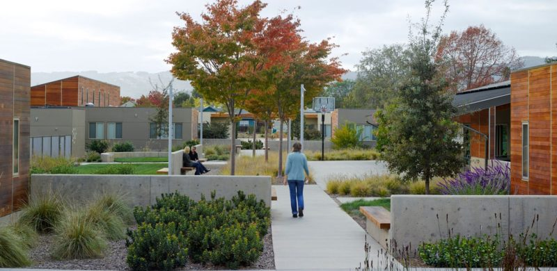 Image of a lady walking trough open concrete pathways
