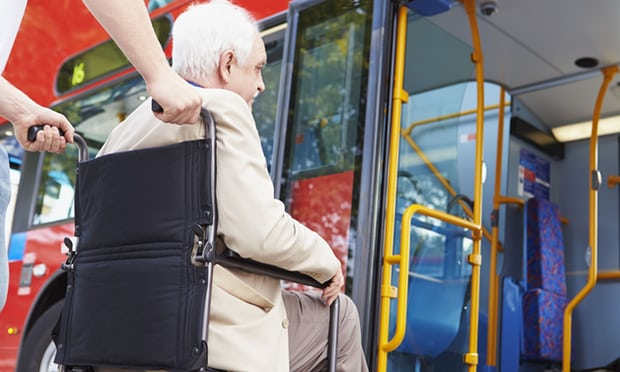 image of man in wheelchair getting on a London bus