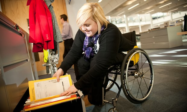 image of woman in wheelchair reaching for files in an office