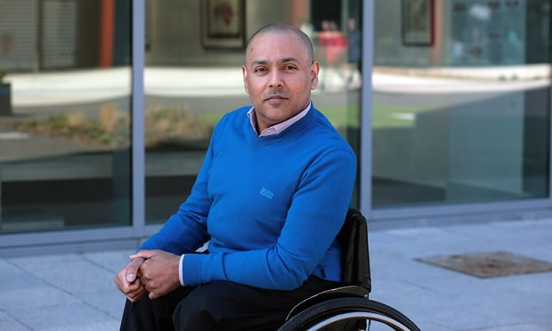 Image of Kamran Mallick in a wheelchair