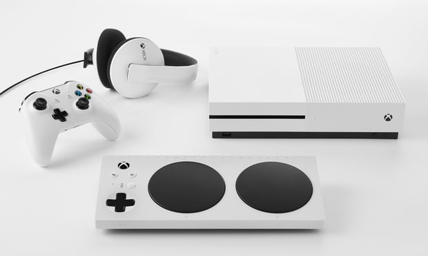 Image of a Microsoft's Xbox adaptive controller and headphones