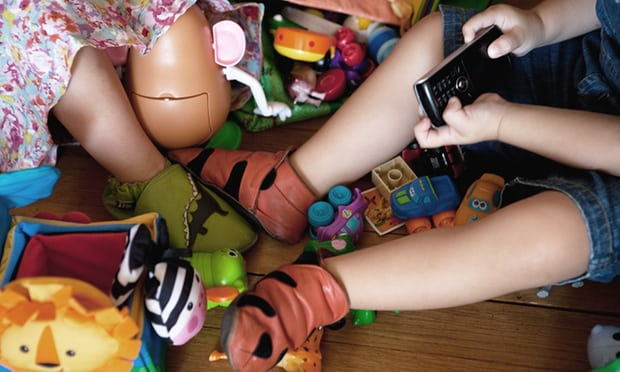 Image of child at play with toys and mobile phone