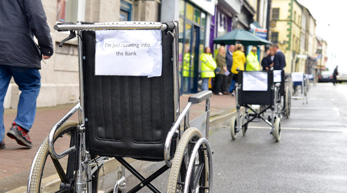 image of wheelchairs parked in car parking spots