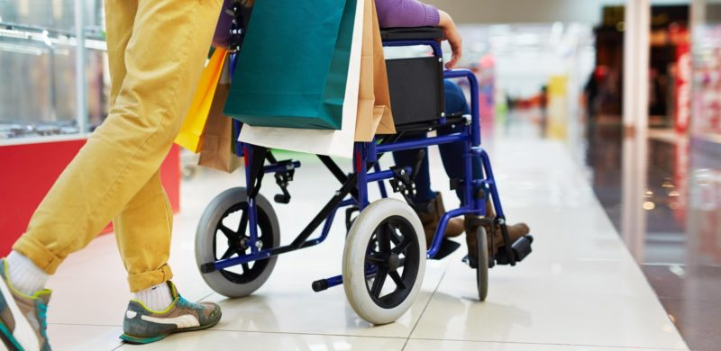 Picture of wheelchair and carer